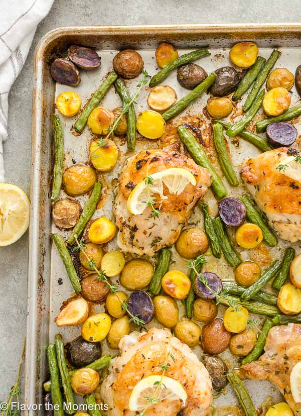 Sheet Pan Lemon Thyme Chicken, Potatoes and Green Beans is all the comforts of a roasted chicken dinner made in one pan in a fraction of the time! FlavortheMoment
