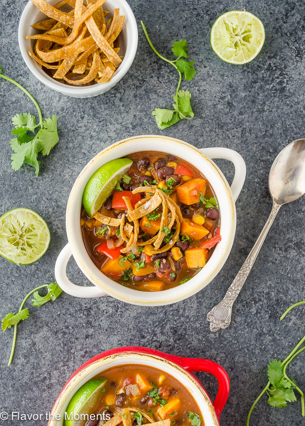 Sweet Potato Black Bean Tortilla Soup is a vegan version of classic tortilla soup that's every bit as hearty! {GF, Veg, V} @FlavortheMomen