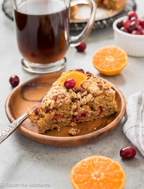 Cranberry Orange Coffee Cake with Pecan Streusel is a lightened up coffee cake that's studded with fresh cranberries and bursting with fresh orange flavor!