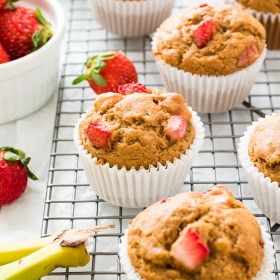 close up of healthy strawberry banana muffins on wire rack