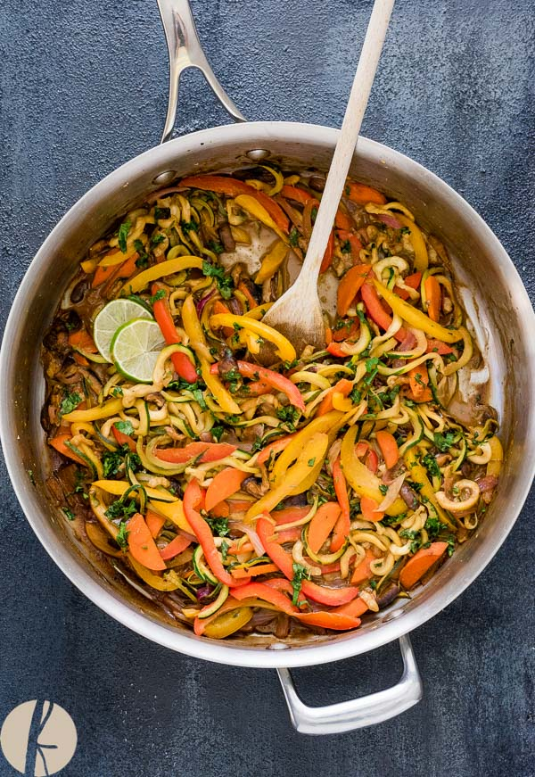 Vegan Thai Peanut Zucchini Noodles is an easy low carb meal packed with zoodles and veggies in a delicious Thai peanut sauce!