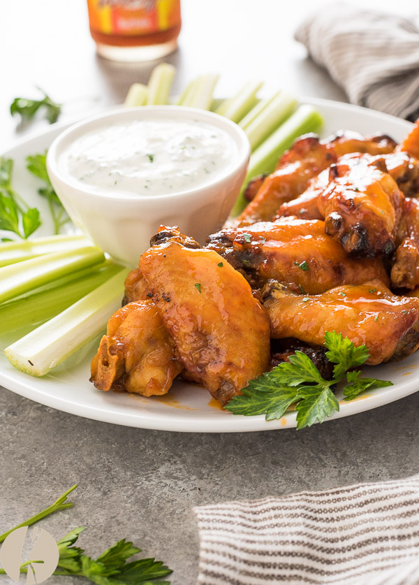 Instant Pot Honey Buffalo Chicken Wings are sticky, sweet and spicy buffalo wings with instructions on both pressure cooker and slow cooker methods!