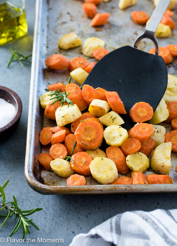 Roasted Carrots and Parsnips are tossed in olive oil and rosemary and roasted to perfection!