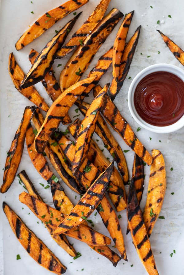 overhead shot of grilled sweet potato fries with ketchup