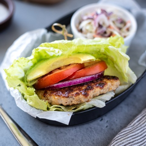 Grilled turkey burgers in lettuce wrap with coleslaw side