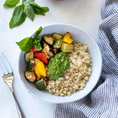 roasted vegetable pesto quinoa bowls overhead shot with linen