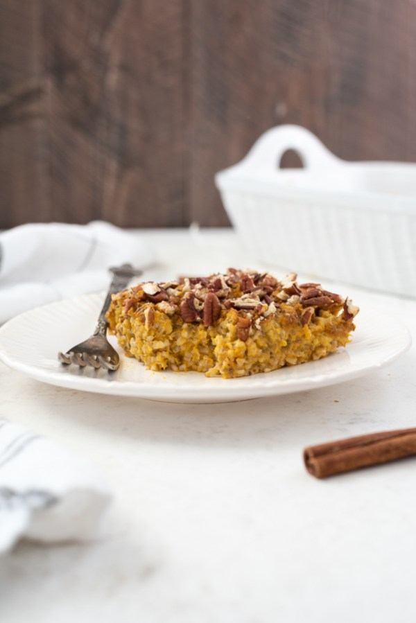 front shot of overnight pumpkin baked steel cut oatmeal with bite out of it