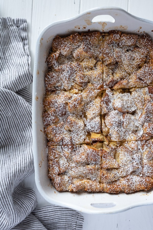 overhead shot of eggnog french toast casserole cut into squares