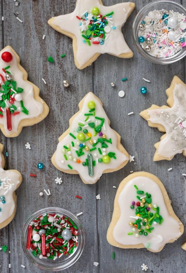 Christmas sugar cookies overhead shot featuring green Christmas tree