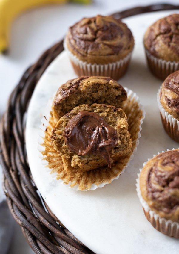 banana nutella muffins cut in half with Nutella spread