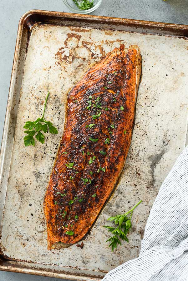 overhead shot of broiled salmon fillet with salmon dry rub and parsley