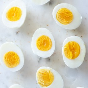 hard boiled eggs cut in half on a marble board