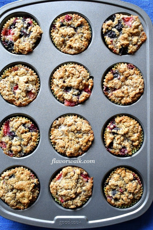 Triple Berry Gluten Free Muffins are bursting with fresh berries! They're extra moist in the middle, crunchy on the outside and perfect for both a breakfast treat or afternoon snack!