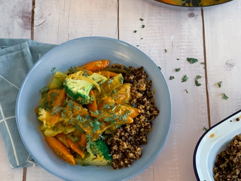 a bowl of sri lankan carrot and broccoli curry served with beluga lentils and quinoa. Recipe from Flavour-Files.com