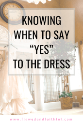 There is a wedding dress in the background on a hanger hanging on the ledge of the glass door frame and a large clock on the wall above the dress. There is also a fake plant on the corner and a window behind the plant. In the foreground, there is a quote saying 'Knowing when to say yes to the dress' and the footer has the link to the blog which is www.flawedandfaithful.com