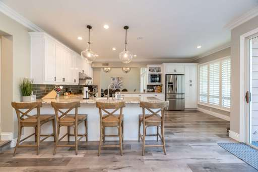 image of an open kitchen w/ wooden floors illustrating believing God for a debt free house, biblical financial principles