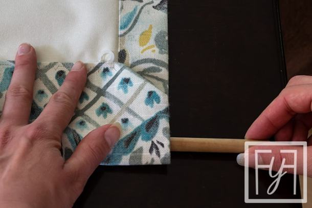 inserting dowel rod into hem of flat roman shade