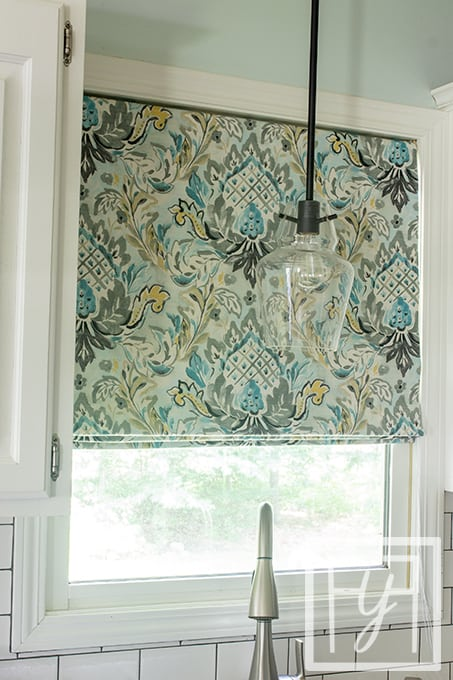 blue and green print flat roman shade in kitchen