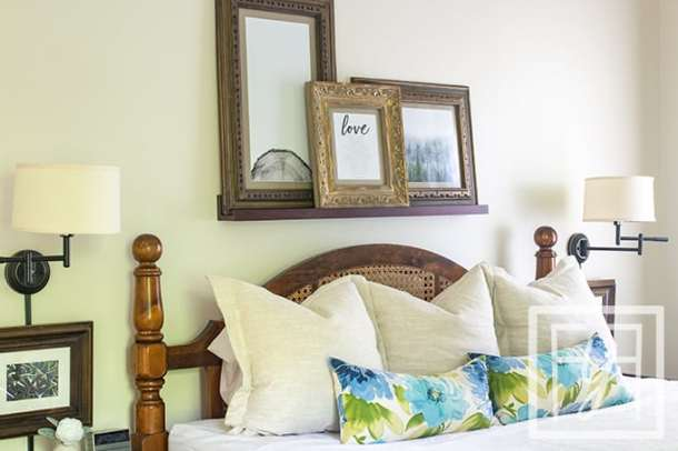 three large vintage frames over king sized bed