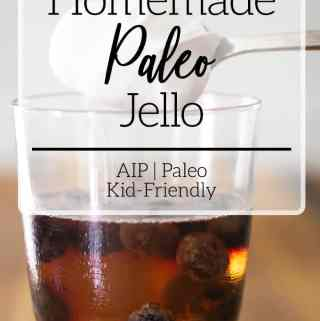 Paleo jello with blueberries in glass cup