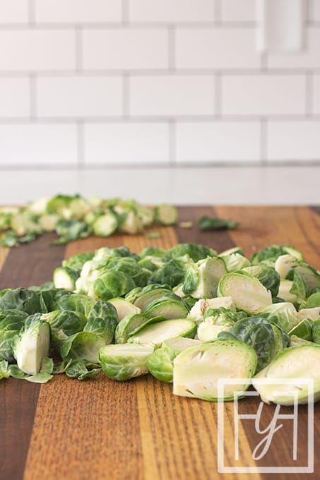 halved brussels sprouts on cutting board