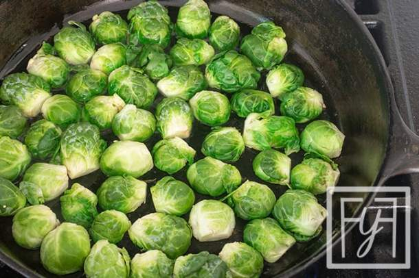 sautéed brussels sprouts in cast iron pan