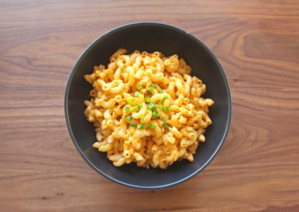 Photo of delicious and creamy Vegan Thai Curry Mac and Cheese with chives on top