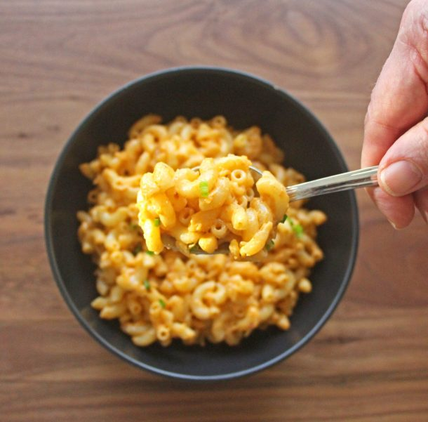 Close up photo of a spoonful of Gluten-Free and Vegan Thai Curry Mac and Cheese