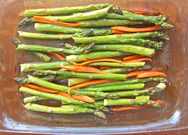Roasted spring vegetables, balsamic roasted asparagus and carrots in a baking dish