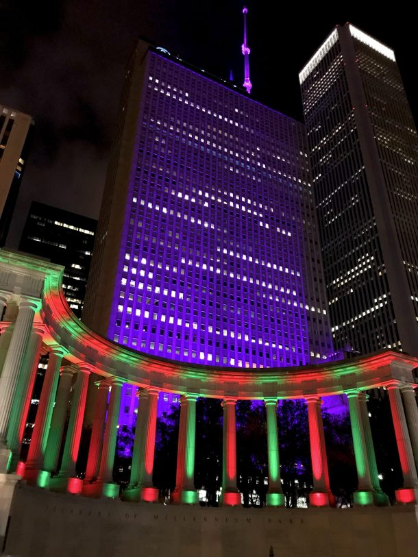 Millenium Monument lit up in green and red for Christmas in Chicago