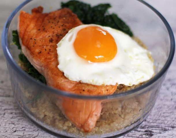Healthy Salmon and Quinoa Breakfast Bowl with close up of sunny side up egg and salmon