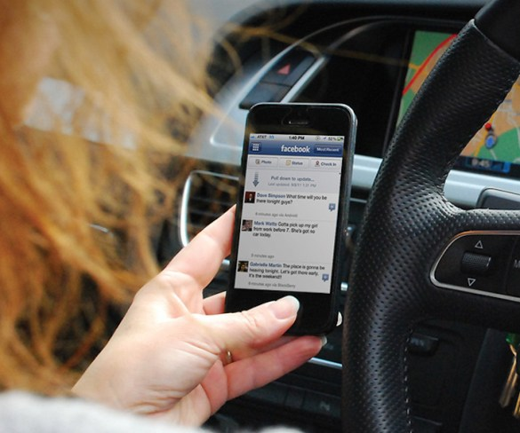 One in three drivers use handheld mobile phones