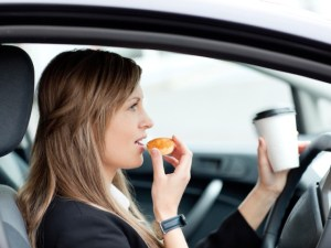 Driver eating behind the wheel