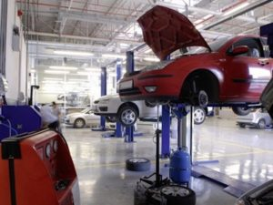 Cars on ramps in workshop