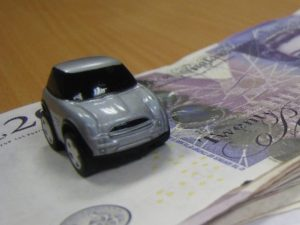 Toy car on pile of money