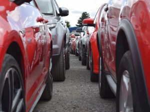 Row of red and grey cars