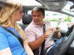 Girl undertaking driver training in vehicle