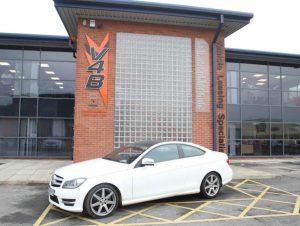 White Mercedes outside V4B headquarters