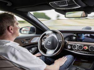 Man behind wheel of autonomous car