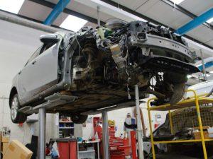 Damaged car in body shop