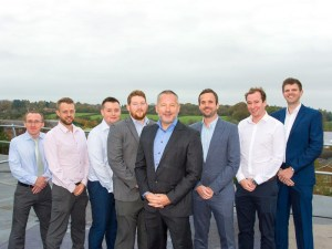 Synergy Automotive MD, Paul Parkinson (centre) and team members
