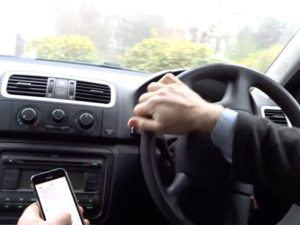 One in 10 drivers believe the road safety risks of using a handheld phone are 'overstated'