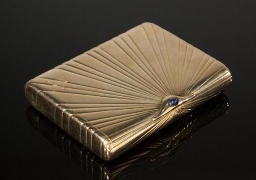 14K gold oval cigarette case with sapphire push button by Faberge.