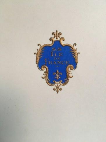 An embossed Île de France menu cover.