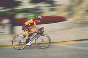 a guy rides a road bike for a great cardio workout