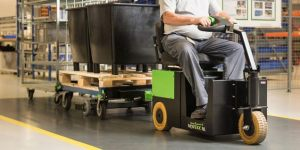 Movexx ride-on tugger being used in a heavy duty industrial application that would be traditionally handled with mutliple forklift runs.