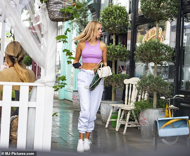Kimberley Garner shows off her taut abs and impressively svelte figure