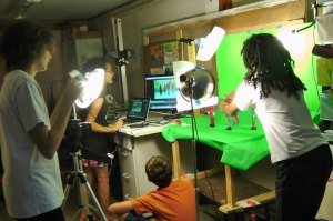 The team of four animating puppets in front of a green screen.