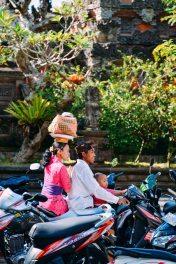 Balinese hindu family on a motorbike leaving the temple. Galungan 2014 in Ubud, Bali