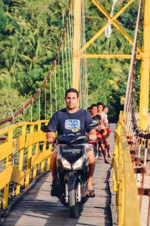 Abraham crossing the bridge on his motorbike